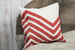 Square White Throw Pillow with Red Zigzags Design Royalty Free Stock Images