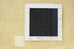 Square window. With bar, architectural detail of Portuguese house Stock Photography