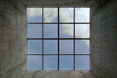 Square window. Square light well on a concrete Stock Image