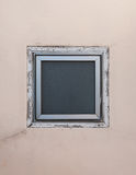 Square window on beige wall Royalty Free Stock Image