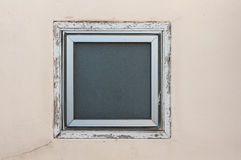 Square window on beige wall Stock Photo