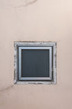 Square window on beige wall Stock Photography