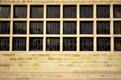 Square window and brick all pattern background. Black square windows and brown brick wall pattern horizontal background Royalty Free Stock Photos