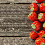 Square wooden background with fresh strawberries Stock Photography