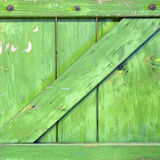 Square Wooden Box. Green square wooden box with texture and bolts along the top Royalty Free Stock Images