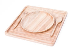 Square wooden dish set with spoon, on white background Stock Image