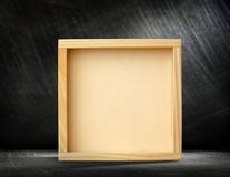 Square wooden frame. Blank new square wooden frame as background Royalty Free Stock Photo