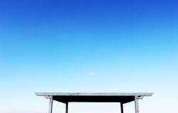 Square wooden shed on pedestals, blue sky Royalty Free Stock Photo