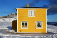 Square yellow house in Norway Royalty Free Stock Images
