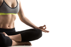 Square Yoga Pose. Sporty fit beautiful young woman in sportswear bra and black pants working out, sitting in Fire Log pose, Square Posture for hips and groins Royalty Free Stock Photos