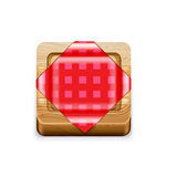 Squared cutting board with napkin  on white Royalty Free Stock Photography