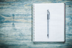 Squared Notepad Pen On Wooden Board Office Concept Stock Photo