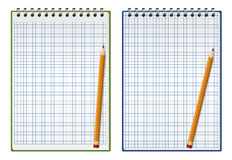 Squared notepad with pencil Stock Images