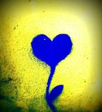 Squared painting of heart combined with plant on the wall - blue and yellow Stock Photos