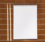 Squared paper loose-leaf note sheet and chopsticks Stock Photos