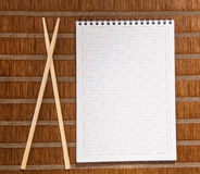 Squared paper loose-leaf note sheet and chopsticks Stock Photo