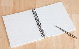 Squared paper loose-leaf note sheet and pen Stock Images