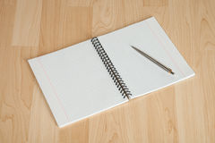 Squared paper loose-leaf note sheet on the table Stock Image