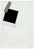 Squared paper page and blank photo Royalty Free Stock Photo