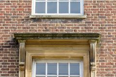 Squared Pediment above Window in Brick Wall. Shallow Depth of Field Architecture Details Stock Photo
