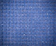 Squared tile for blind pedestrians on the sidewalk with vignette. texture, background. Blue squared tile for blind pedestrians on the sidewalk with vignette stock photos