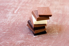 Squares of assorted chocolate Stock Photos