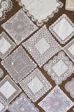 Squares of beautiful hand made lace. Royalty Free Stock Photo