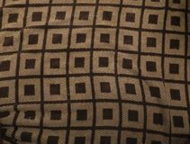 Squares on squares. Brown, squares, big squares,ruff,indoors Stock Images