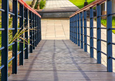 Squares and converging lines on a boardwalk at the residential precinct of the Point area in Durban. Royalty Free Stock Images