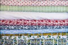 Squares of painted ornamental cloth Stock Photo