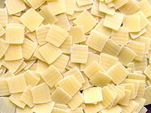 Squares of pasta background Stock Photography