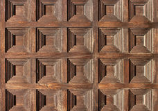 Squares pattern on old wooden door. Squares pattern of old wooden door royalty free stock photo