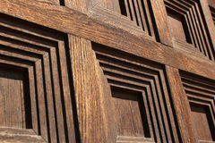 Squares pattern on old wooden door, closeup image.  Stock Photography