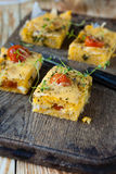 Squares of polenta with cheese Royalty Free Stock Images