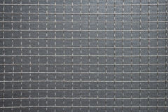 Squares of Wire Mesh Against Grey Background. Stock Images