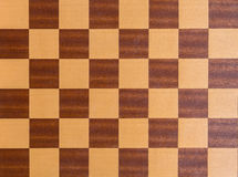 Squares of a wooden chessboard background Royalty Free Stock Photo