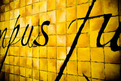 Squares Yellow. Close up picture of a painted wall with bright yellow squares and black letters Royalty Free Stock Photos