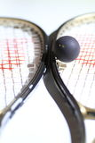 Squash. Ball with two raquets for versus stock photos