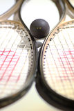 Squash. Ball with two raquets for versus Royalty Free Stock Photos