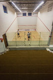 Squash Teenagers Court Playing. Squash court arena with school teenagers playing and practicing at Westville Country club Stock Image