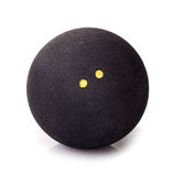 Squash ball isolate. Squash ball with two dots isolated on white. Closeup of black rubber squash ball stock photo