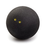 Squash ball isolated on white. Squash ball with two dots isolated on white with clipping path. Closeup of black rubber squash ball royalty free stock images
