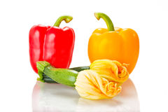 Squash blossoms and peppers Royalty Free Stock Photos