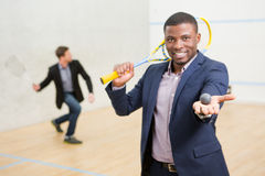 Squash businessmen players Stock Photography