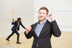 Squash businessmen players Royalty Free Stock Images