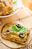 Squash caviar with olives, parsley and rye bread Stock Photography