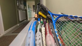Squash club box of rackets Royalty Free Stock Photography