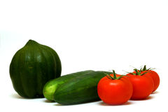 Squash, cucumbers and tomatoes. Isolated squash, cucumbers and tomatoes Royalty Free Stock Photography