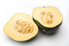 Squash (Cucurbita pepo). Acorn squash (Cucurbita pepo) cut in 2 with seed showing Stock Photos