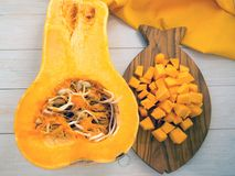 Squash on the fish shaped board. Winter squash on the fish shaped board Royalty Free Stock Photography